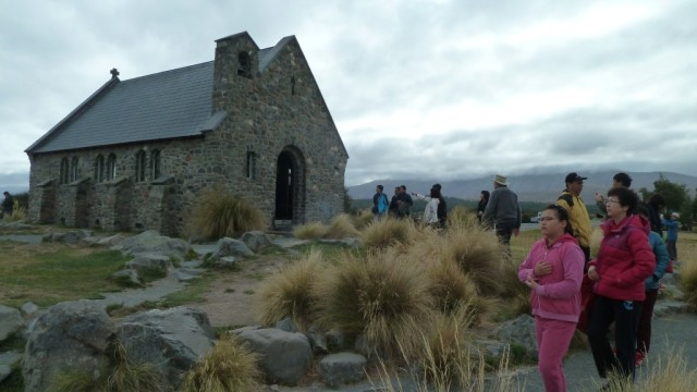 asian tourists at church of the good sheperd by lake tekapo