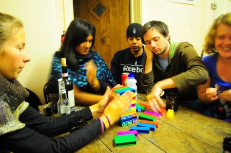 Dan playing jenga and looking miserable