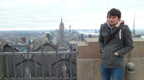 daniel looking miserable on top of rockerfeller centre