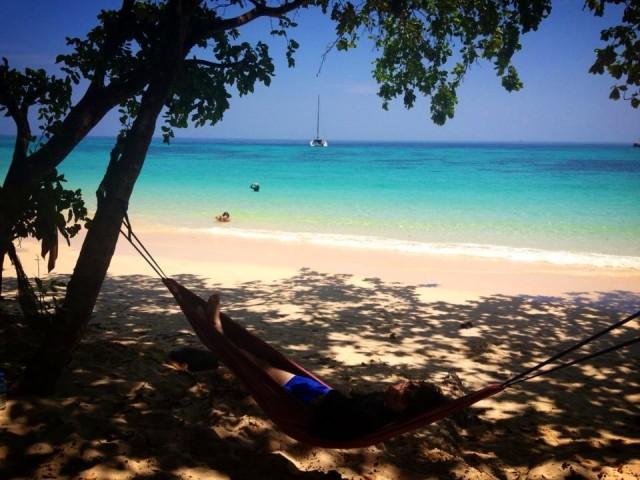 daniel lying in hammock on a beautiful beach