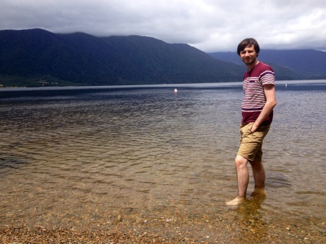 daniel paddling in lake kaniere
