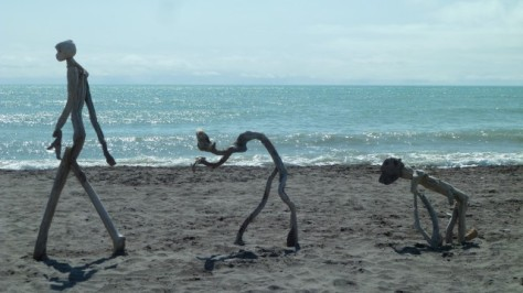 hokitika beach sculpture of baby growing up