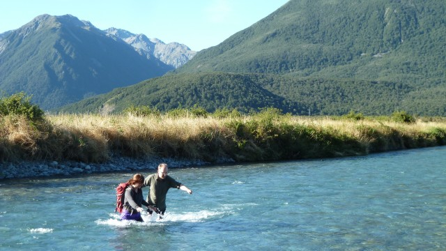 jamie crossing river in arthurs pass