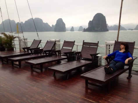 jamie relaxing on a boat in ha long bay