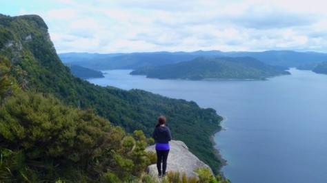 jamie standing at cliffs edge above lake waikaremoana