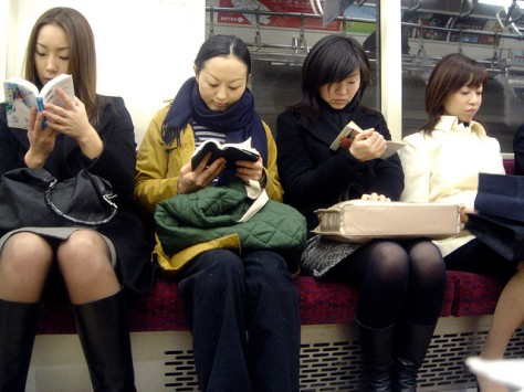 japanese women ignoring each other on tokyo subway