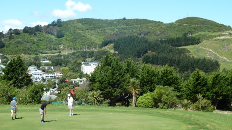 Kiwis playing golf in Wellington, New Zealand.