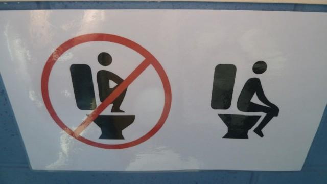 no squatting on toilet sign in mount john toilets