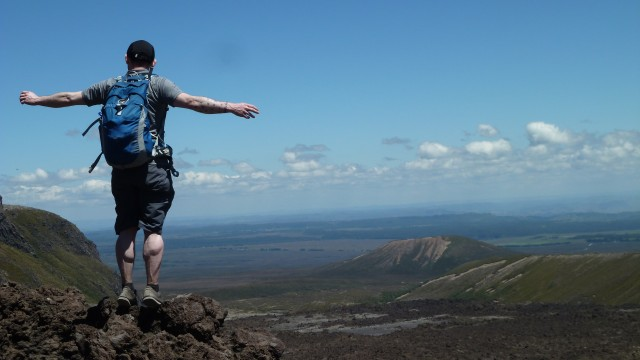 photo of tourist with arms wide open on tongariro crossing