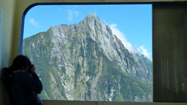 tourist taking photo on milford sound cruise