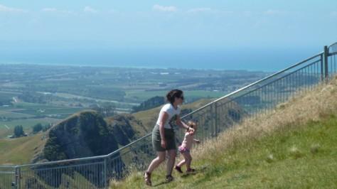 woman and child walking up te mata peak